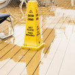 Yellow Warning Cone on Wet Deck — Stock Photo
