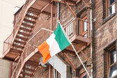 Irish Flag on Old Red Brick Buildings — Stock Photo