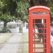 Red Phone Booth in Park — Stock Photo