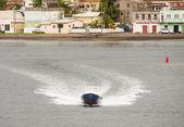Blue Boat Leaving Colorful Coast — Stock Photo