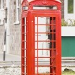 Red PHone Booth by Old Stone Building — Stock Photo