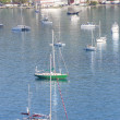 Stock Photo: Blue and Green Sailboats in Bay