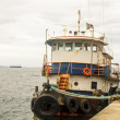 Stock Photo: Old Blue and White Tug on Dock