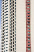 Beige and Red Condo Tower with Balconies — Stock Photo