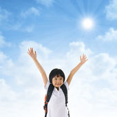 Asian school girl arms up in the air — Stock Photo