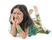 Little Indian girl lying on floor — Stock Photo