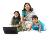 Traditional Indian family with laptop — Stock Photo