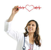 Doctor drawing a heartbeat — Stock Photo