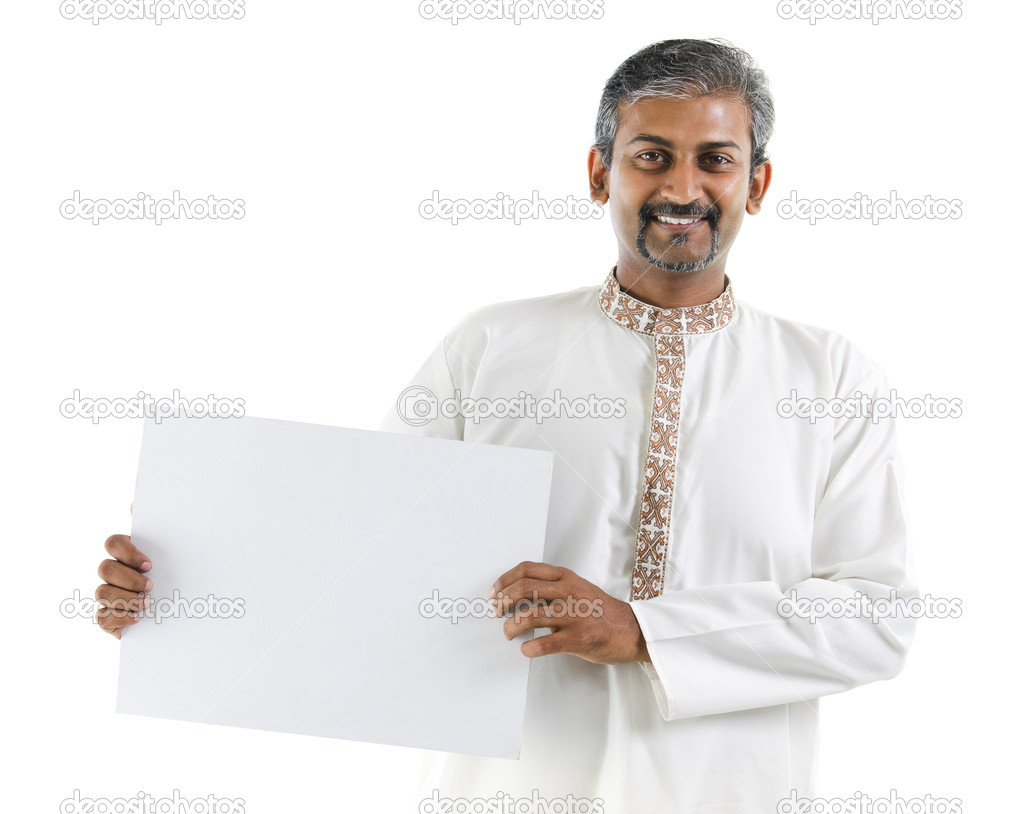 Mature Asian Indian businessman holding a white board standing over white background — Stock Photo #11501487