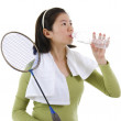 Stock Photo: Drinking water after playing badminton
