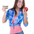 The girl picks an apple or a cake — Stock Photo