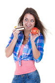 Portrait of a girl with an apple and a cake — Stock Photo