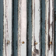 A background of closeup weathered white painted wood — Stock Photo