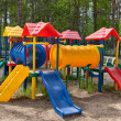 Children colorful playground in park - Stock Photo