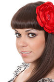 Beautiful woman with fabric rose flower in her hair — Foto de Stock