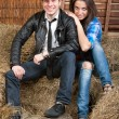 Young couple cowboys on the hay — Stock Photo