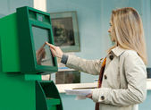 A young girl and an ATM — Stock Photo