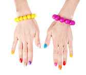 Women's hands with a fashionable multi-colored nail polish with — Stock Photo