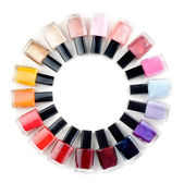 Coloured nail polish bottles stacked circle — Stock Photo