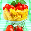 Delicious cherry tomatoes with pasta in goblet — Stock Photo