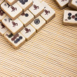 Old chinese game mahjongg on bamboo mat background — Foto Stock