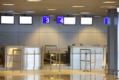 Modern interior of airport terminal check-in — Stock Photo
