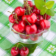 Sweet cherry fruits in glass goblet — Stock Photo