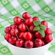 Sweet cherry fruits in white bowl — Stock Photo