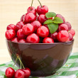Sweet cherry fruits in brown bowl - Stock Photo