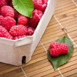 Royalty-Free Stock Photo: Delicious sweet raspberries on wooden background