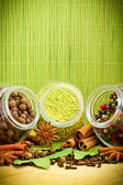 Pack of several spices and herbs in glass jars — Stock Photo
