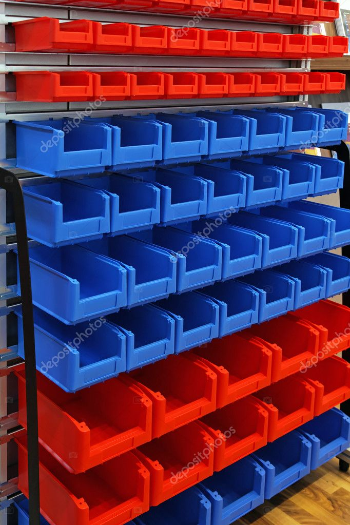 Blue and red plastic bins at sorting shelf in warehouse — Stock Photo #10891440