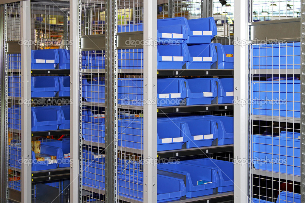 Blue plastic sort boxes in shelf — Stock Photo #10928107