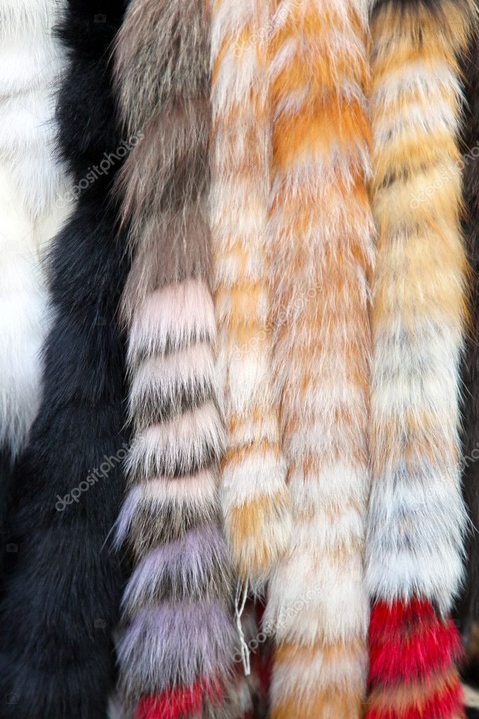 Bunch of modern fur shawls at display — Stock Photo #11457964