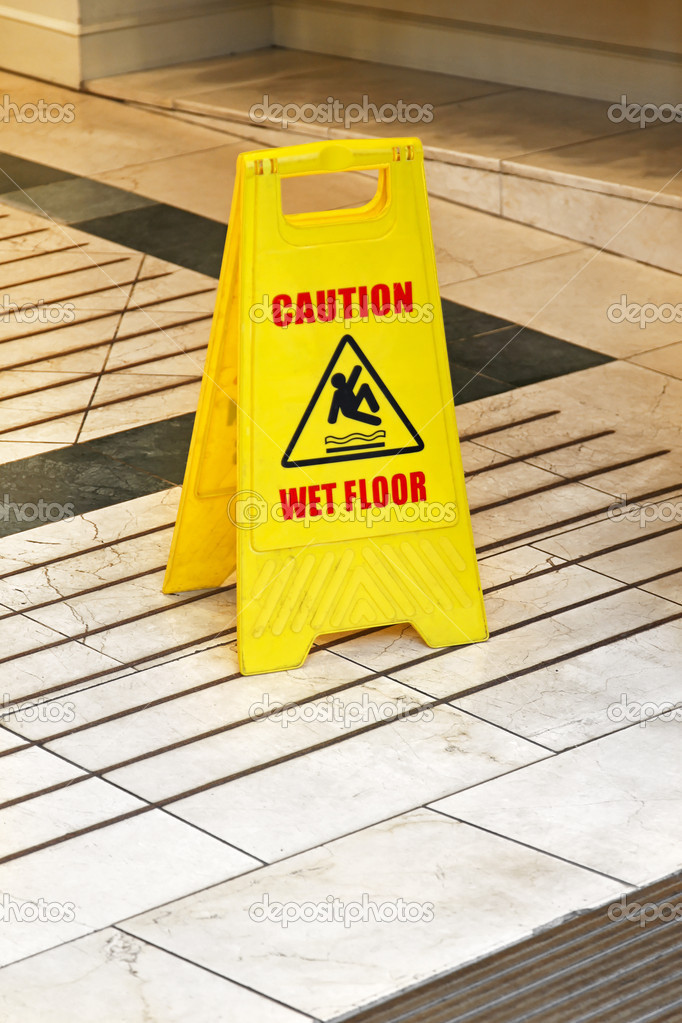 Yellow caution sign for wet floor warning — Stock Photo #11644340