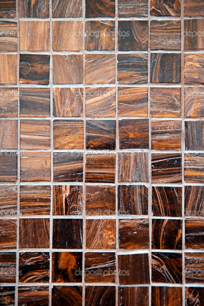 Small square mosaic tiles made from brown marble — Stock Photo #12009755