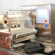 Foil packaging machine - Stock Photo