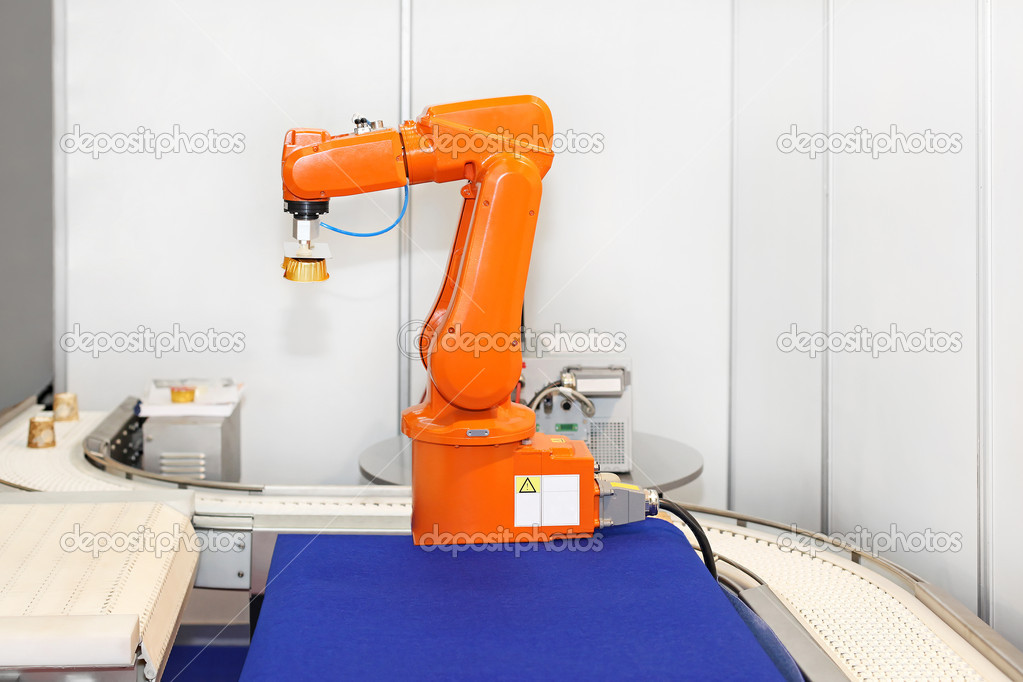 Robotic arm at automated factory production line — Stock Photo #12186411