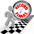 Stock Photo: Record Time Runner Beats Clock for Best Timing