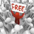 Free Sign Man Holding Giveaway Banner in Crowd — Stock Photo