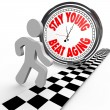 Stay Young Beat Aging Race Against Time Clock - Foto Stock