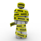 Person Wrapped in Yellow Danger Tape Warning Caution — Stock Photo