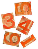 Red orange numbers in wood type — Stock Photo