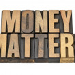 Money matters in wood type — Stock Photo