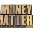 Money matters in wood type — Stock Photo #10993889
