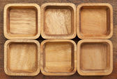 Six square wooden bowls — Stock Photo