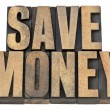 Save money in wood type — Stock Photo #11392489