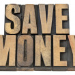 Save money in wood type — Stock Photo
