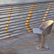 Metal chair at waterfornt — Stock Photo