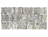 Alphabet in metal type — Stok fotoğraf